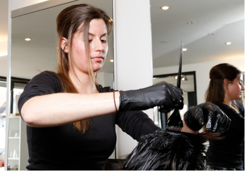 Hairdresser Using Black Disposable Gloves